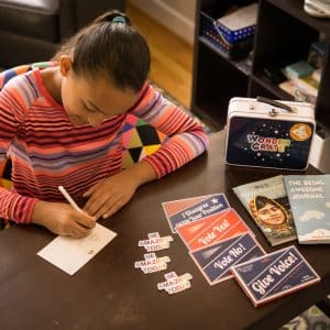 girl playing with malala toys from Wonder Crate Kids Subscription Box For Kids